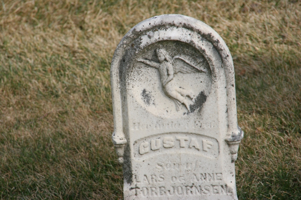 A gravestone in the old part of the cemetery surrounding the church.