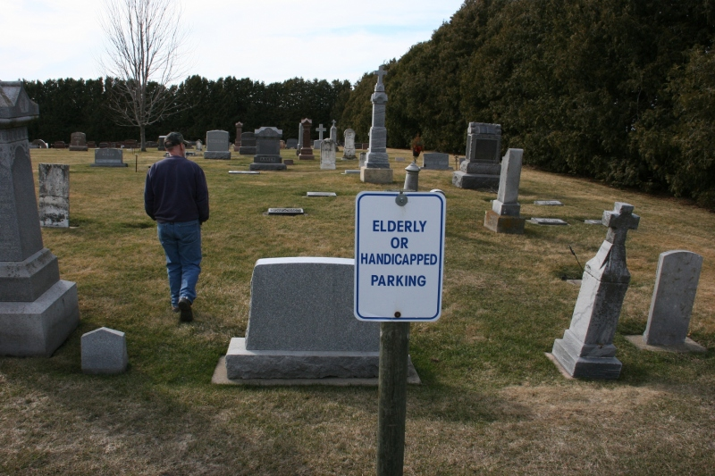 I trail Randy from the back church parking lot into another section of the cemetery.