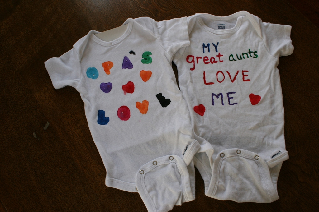 """The other grandpa, who will be called """"Opa,"""" painted the shirt on the left."""