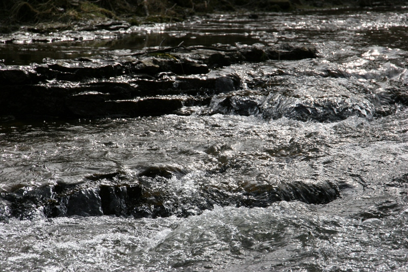 Water rushes over limestone ledges.