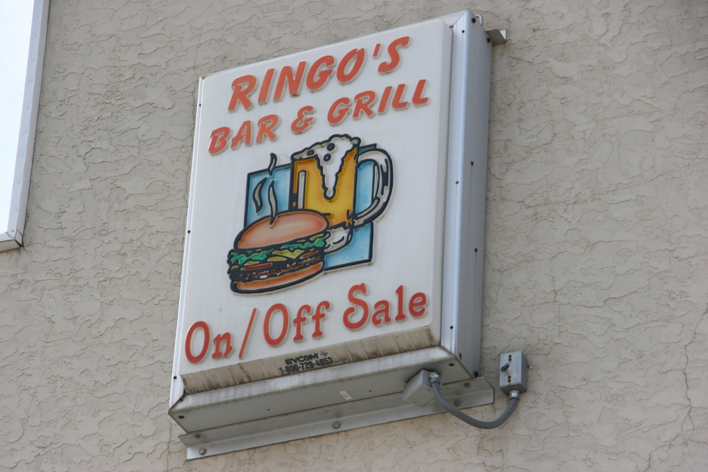 Small town Wanamingo, 38 Ringo's sign above bar