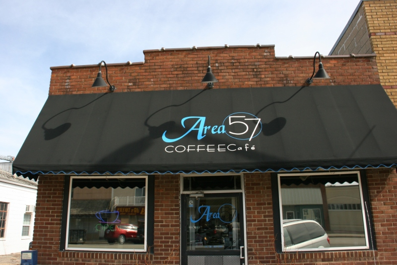 A signature black awning and classy lighting grace Area 57.