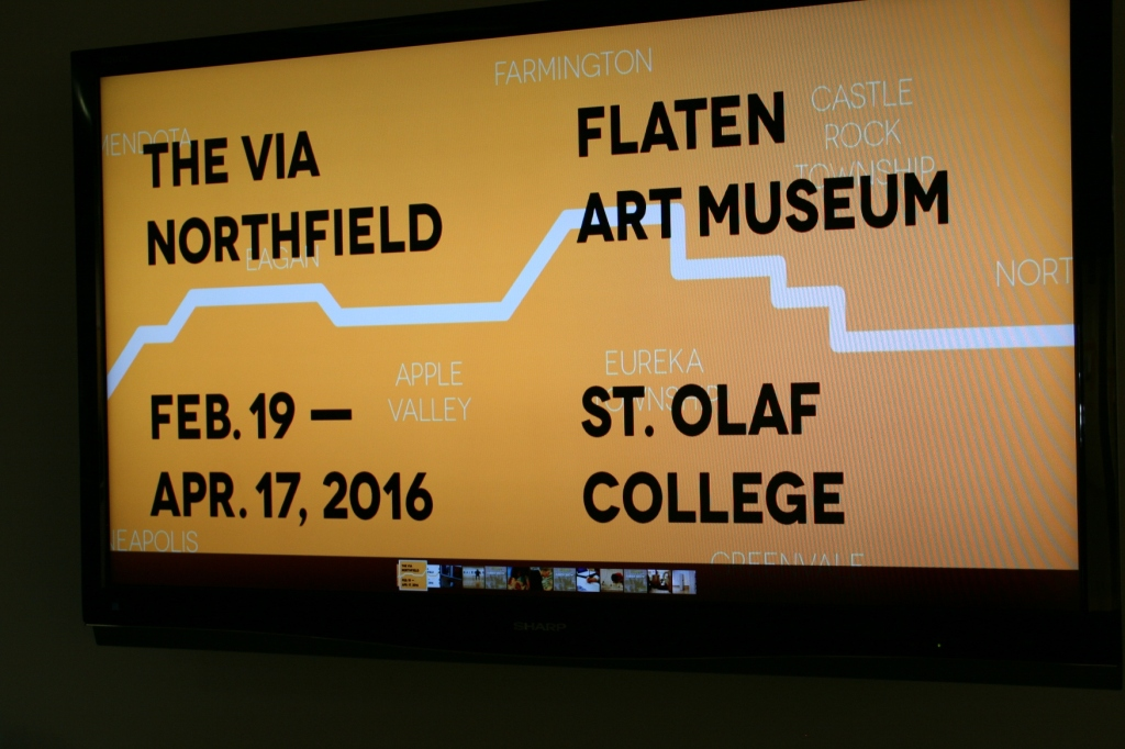 The exhibit is promoted on a screen outside The Flaten Art Museum.