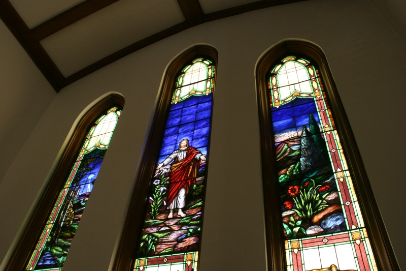 This trio of stained glass windows rises above the altar.