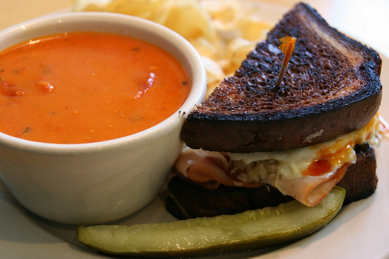 My Rachel sandwich served with red pepper tomato soup, chips and a pickle.