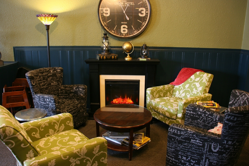 A welcoming spot inside the cafe to read, visit and/or relax.