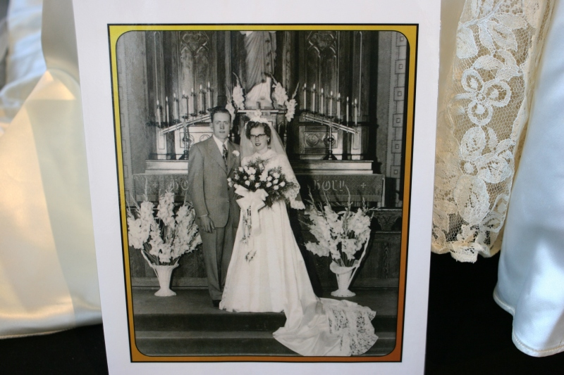 Vintage portraits are part of the exhibit, helping to tell the wedding story.