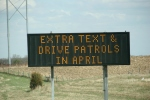 Distracted driving campaign sign, I35 north of Faribault,5
