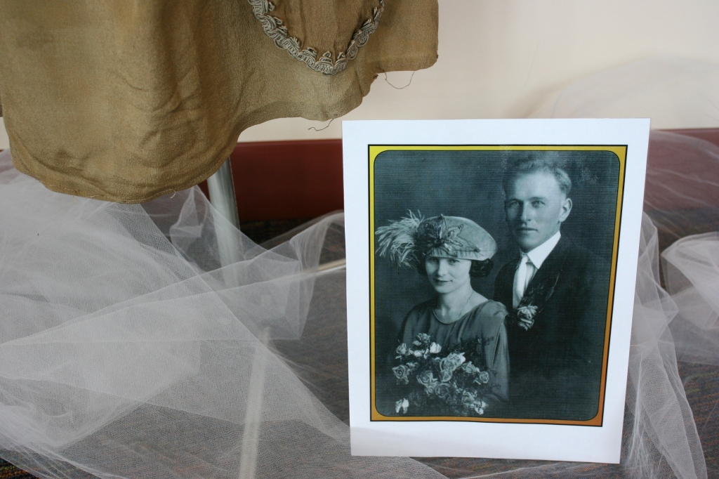 The dress and matching feathered hat worn at this 1923 wedding are in lovely brown tones.