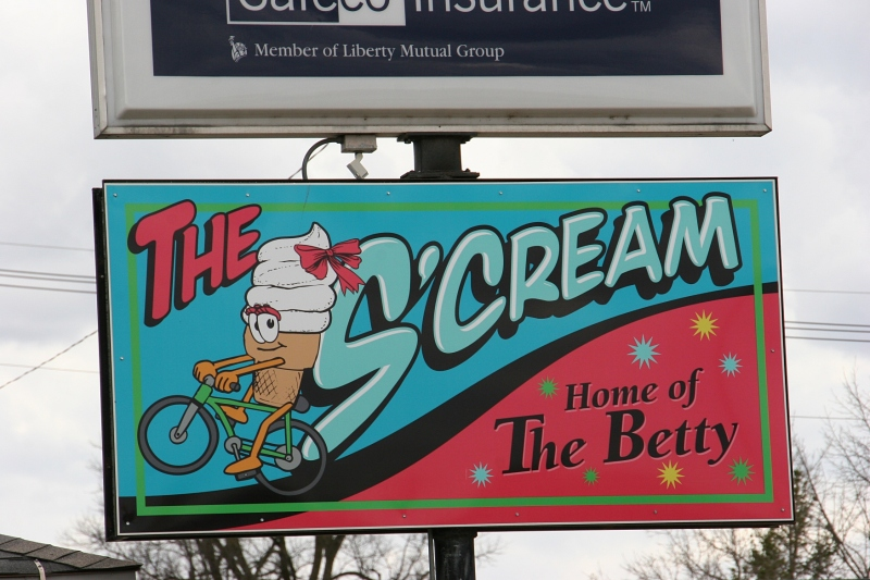 The S'Cream and an insurance agency office are connected.