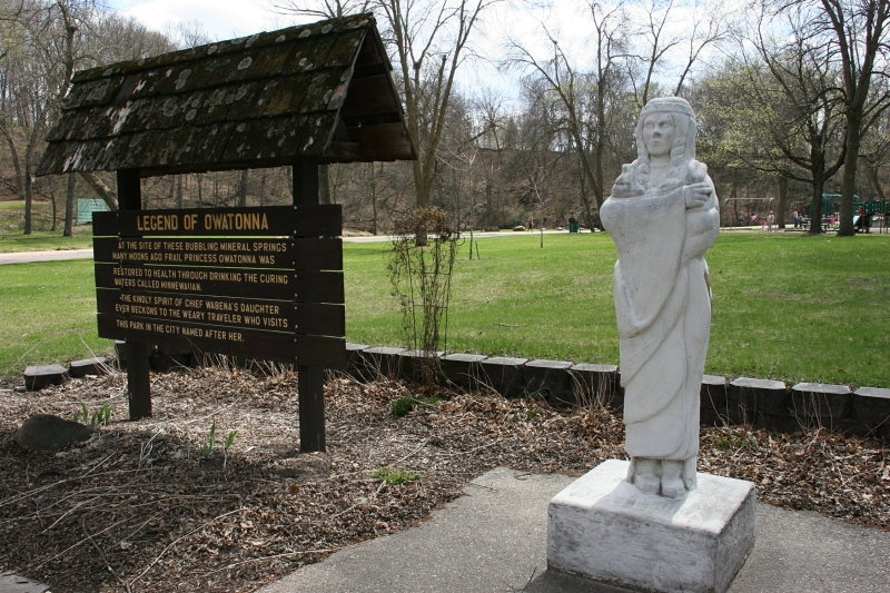 A sign explains the legend of Princess Owatonna, represented in an early 1930s statue in Mineral Springs Park.