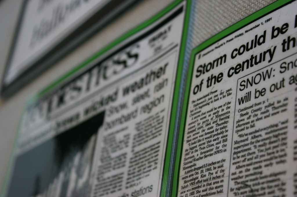 These newspaper articles feature snowstorms in the county.