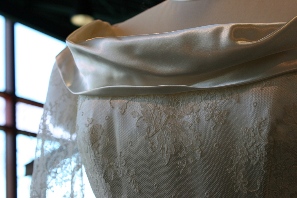 An illusion neckline drapes on a 1949 bridal gown.