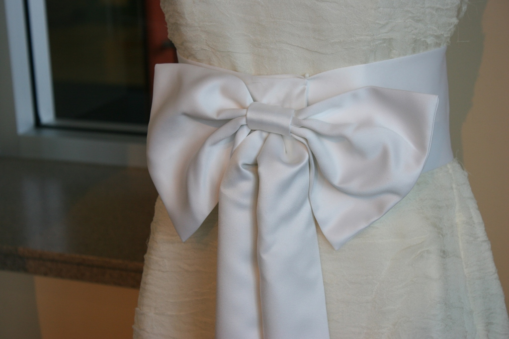 A sash ties in the front of a dress designed by Owatonna native Scott Nylund.