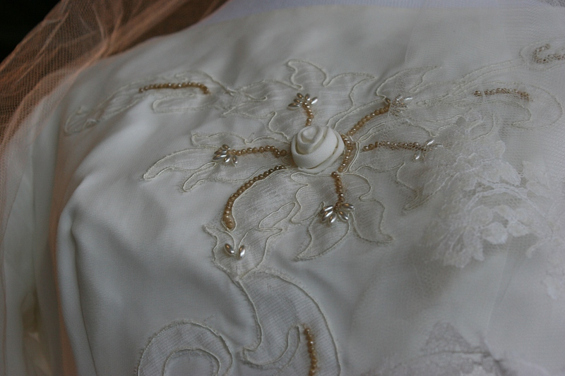 Lovely fabric rosettes adorn a 1964 bridal gown.