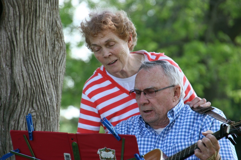 Don, on the guitar, and Judy Chester lead the singing.