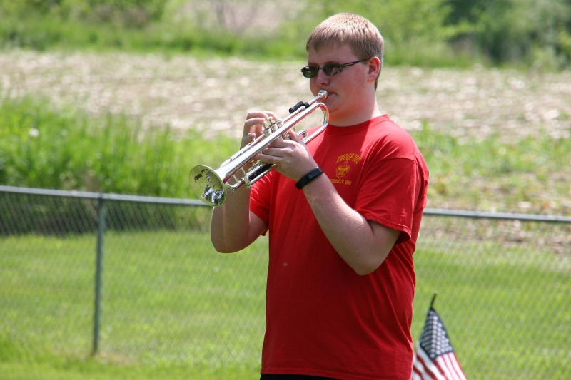 Sam Wilson ends the program by playing taps.