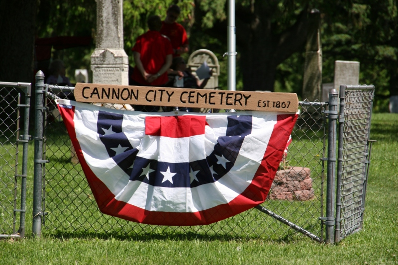 The entrance to the Cannon City Cemetery is decorated for Memorial Day.