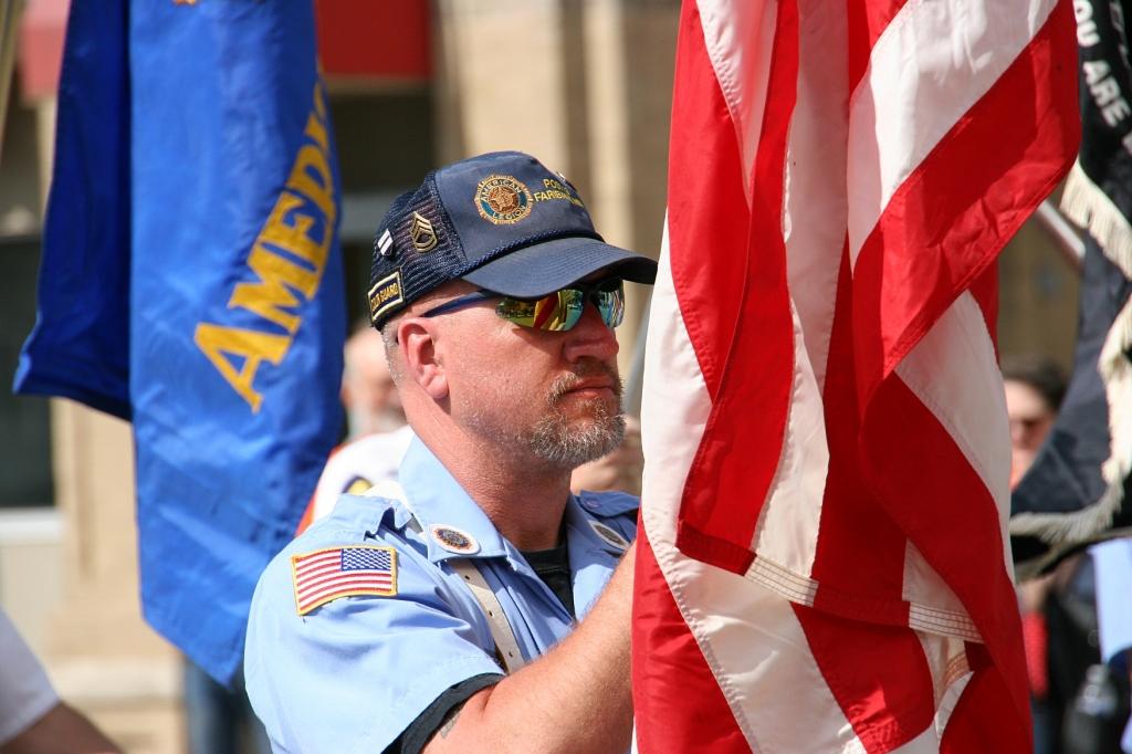 Parade, 12 flag bearer