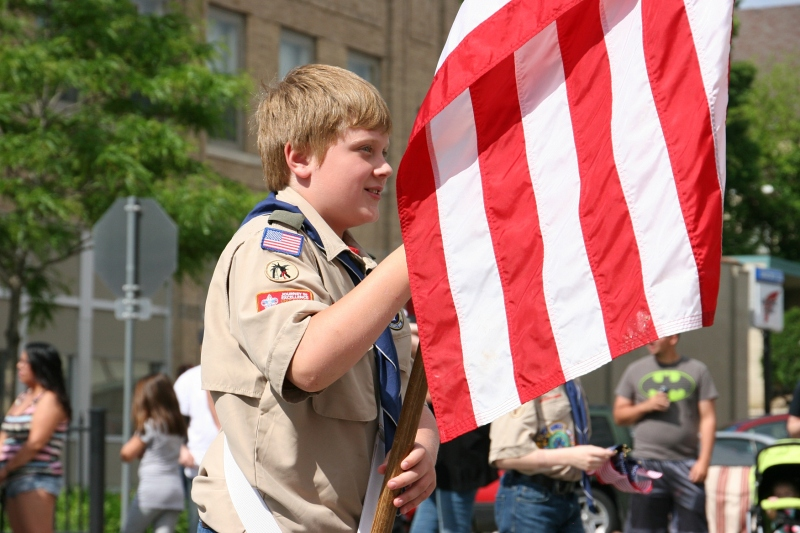 Parade, 28 Scout carrying flag