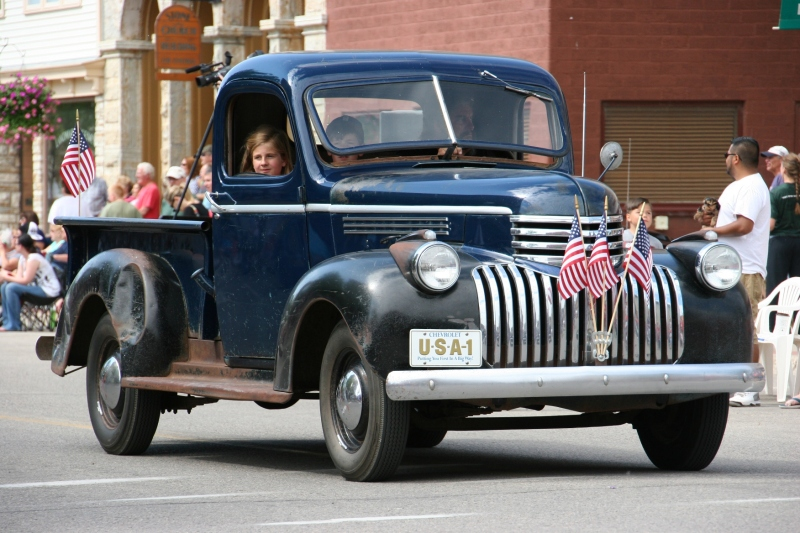 Parade, 45 old blue pick-up truck