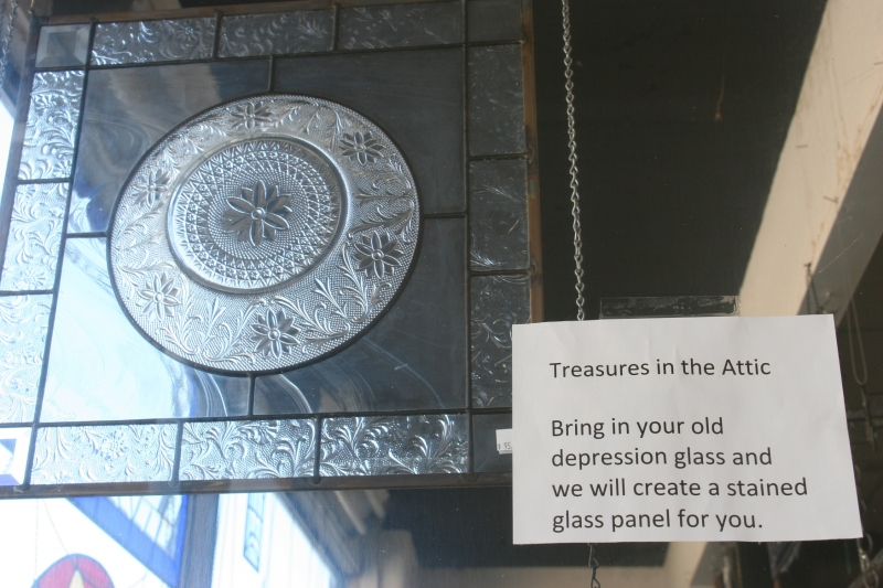 A sign in a window offers a creative option in stained glass.