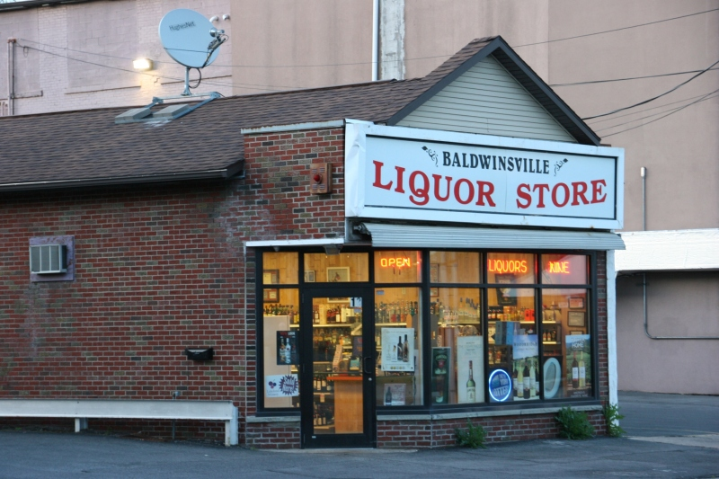 The liquor store is across the street from the diner.