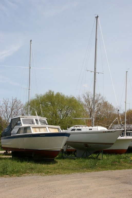 Boats parked near the lake.