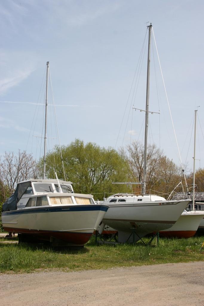Boats parked near the lake.