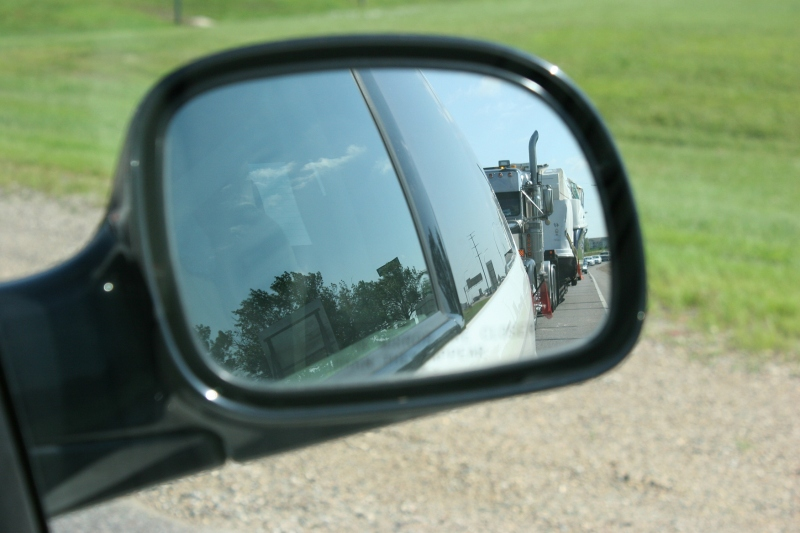 Boat, 9 along I-94 in side mirror