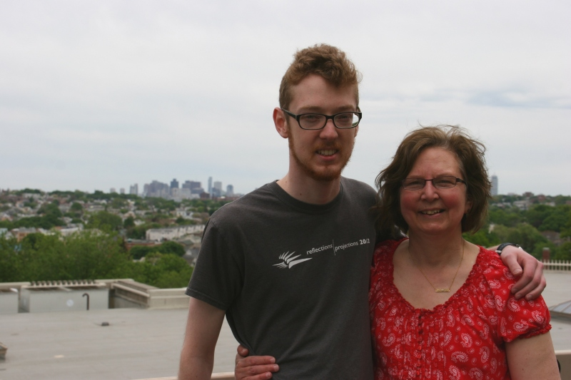 My son and I pose atop the Tisch Library with the Boston skyline as a backdrop.