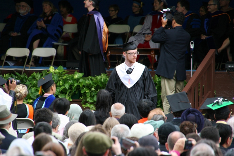 Caleb returns to his seat after graduating from Tufts University School of Engineering with a bachelor of science degree in computer science.