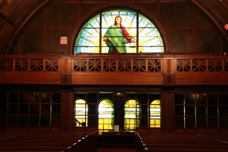 Beautiful stained glass windows and dark wood dominate Goddard Chapel.