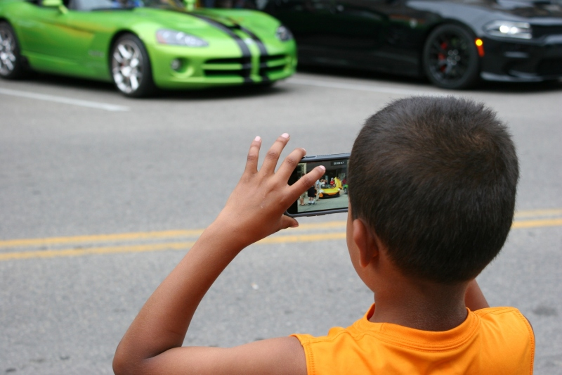 ...this boy so intent on photographing the sports cars that he didn't notice me photographing him.