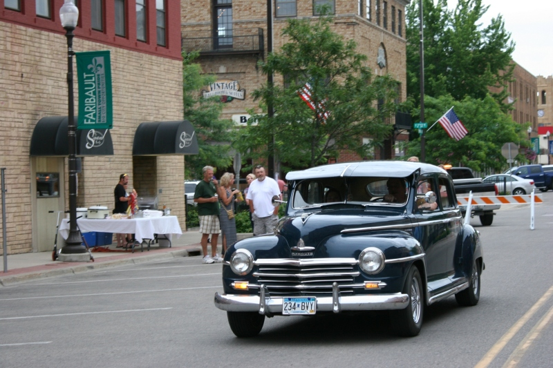 A vintage Plymouth cruises onto Central.
