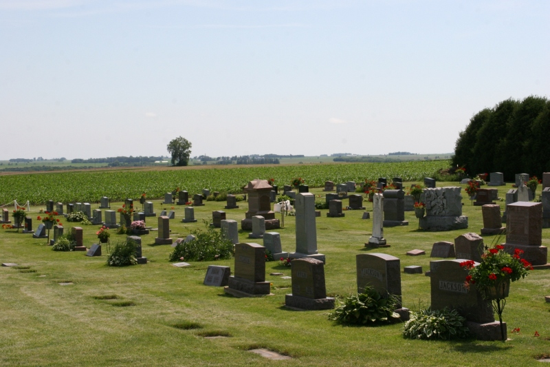 A section of the cemetery that lies next to Emmanuel Lutheran Church and next to a field.
