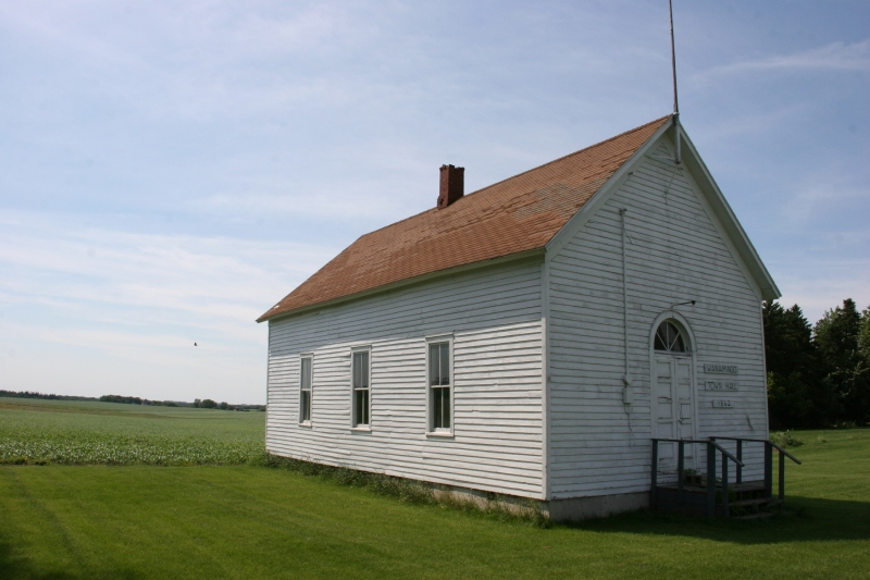 The old Wanamingo Township Hall, built in 1862, stands next to the church.