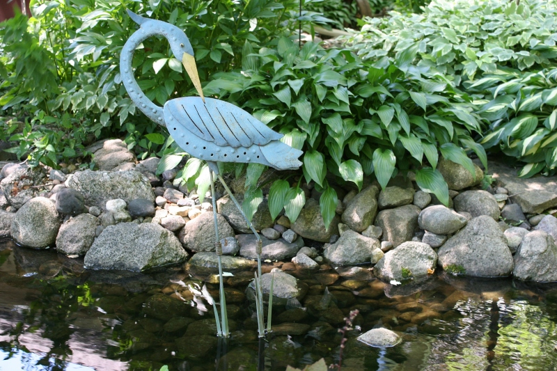 So poetically lovely this blue heron in the pond.