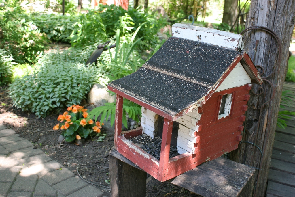 Even the bird feeder fits the rural theme.