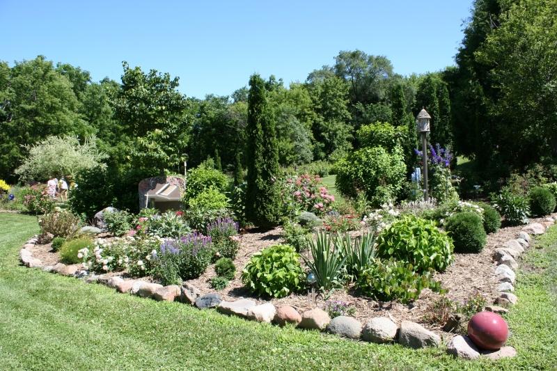 Perennials fill flowerbeds.