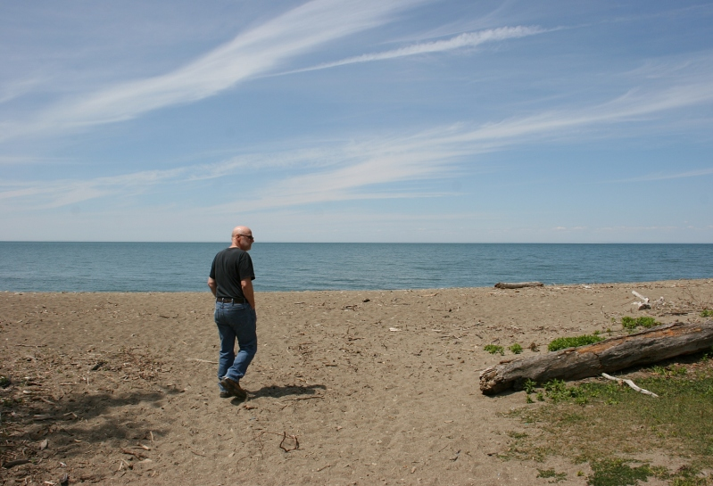 Randy walking along the shore of Lake Erie on a recent road trip to the East Coast.