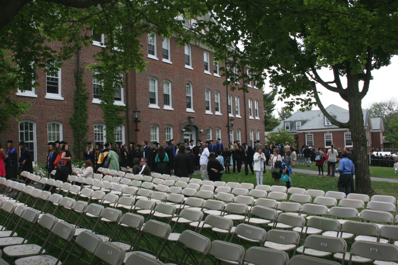 Thousands of chairs covered the campus green for commencement. The event went on, rain or shine. Rain drizzled briefly.