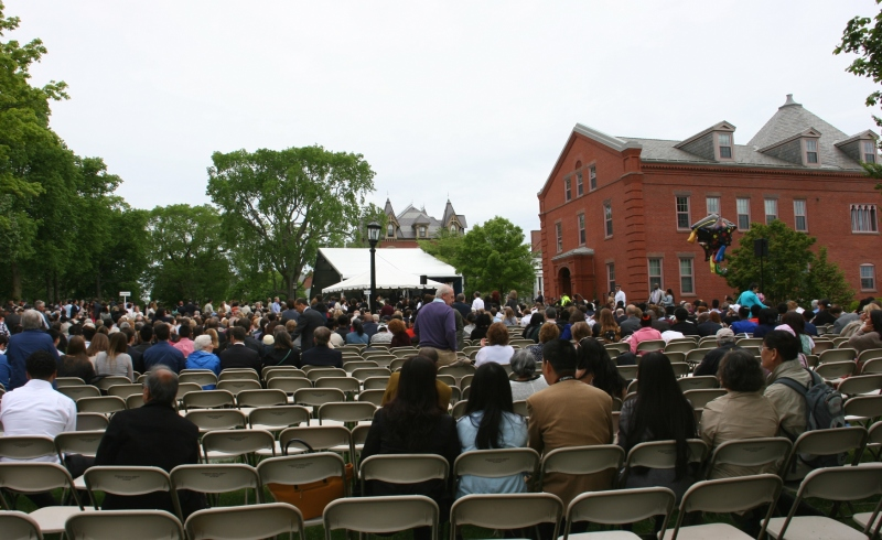 The tented area in the background served as the stage during the all-school commencement ceremony.