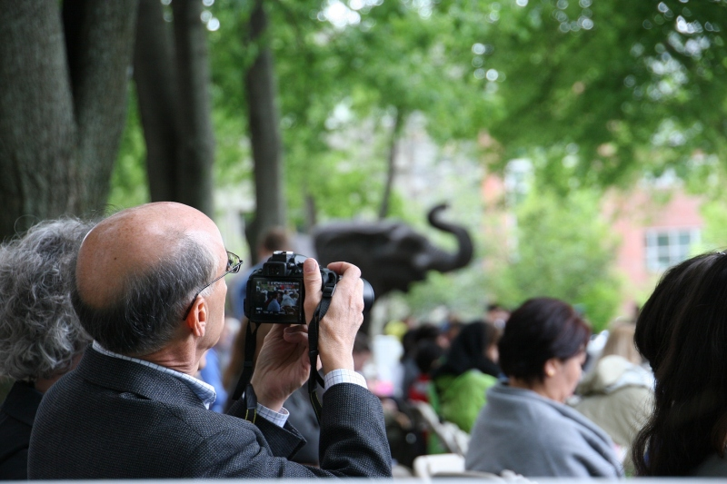 Lots of photos were taken at the ceremony and of Tufts' mascot Jumbo, in the background here.