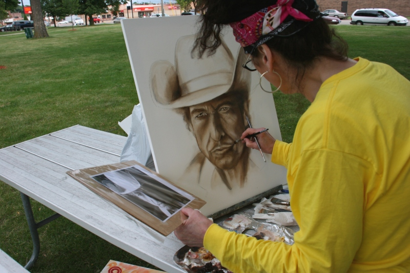 Using a photo as her guide, Dana works on her Dylan portrait.