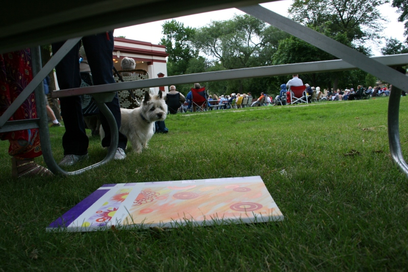 One artist slid her art under a picnic table to protect it from the rain.