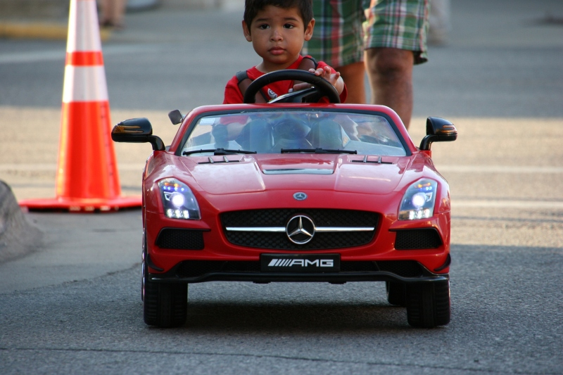Boy in his Mercedes, 70 close-up
