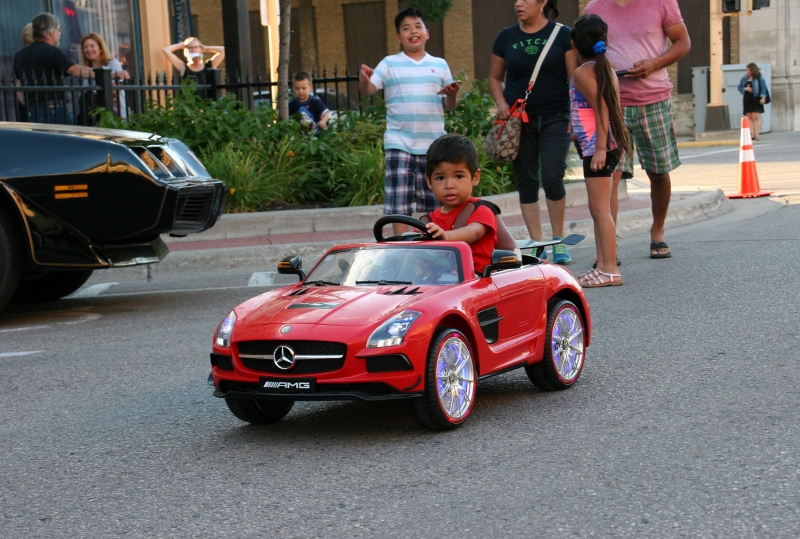 Boy in his Mercedes, 72 family following car