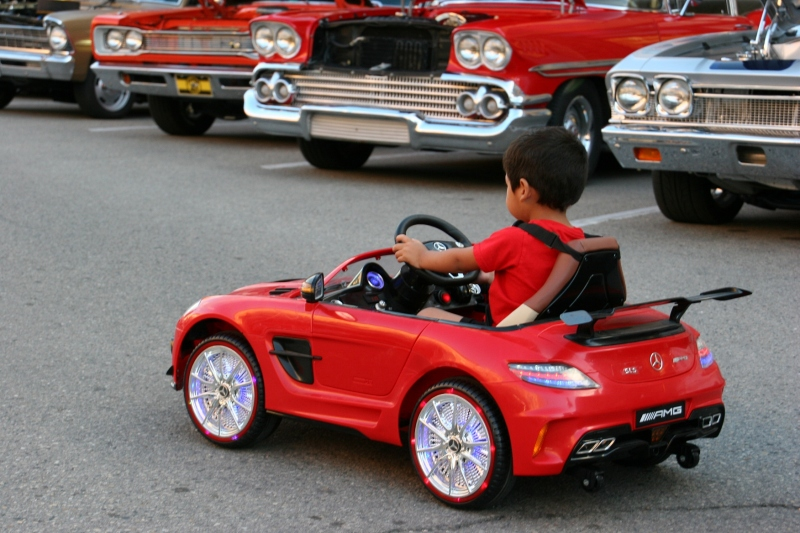 Boy in his Mercedes, 74 next to other cars
