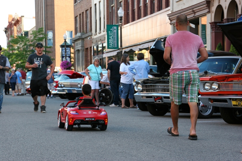 Boy in his Mercedes, 78 father trailing car